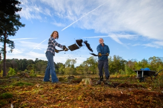 volunteers creating bare ground for improvements to habitat