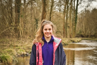 Issy standing in a river