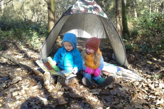 Wild Tots reading in tent