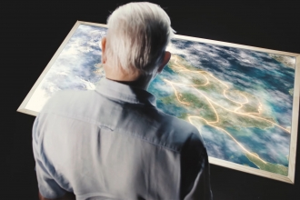 David Attenborough and map