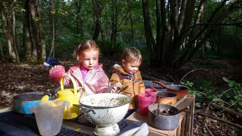 Wild Tots play in a mud kitchen
