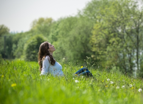 Woman relaxing in field